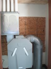 Energy Recovery Ventilation (ERV) unit; main source of heating, cooling and fresh air movement.