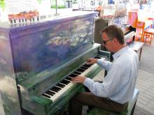 CWRU music department chair, David Ake playing one of the Play Me I'm Yours Pianos