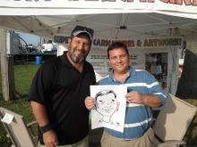 Mike McIntyre with caricaturist Adam Pate.