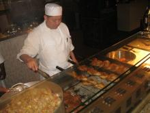 The chef prepares food in the casino's buffet known as The Spread.