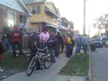 photo of neighbors and media across the street from Sowell residence