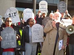 Bill Callahan leads the foreclosure protest at the Justice Center.