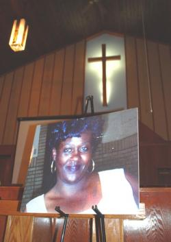 A portrait of Crystal Dozier was on display at Mt. Olive Baptist Church on Saturday morning
