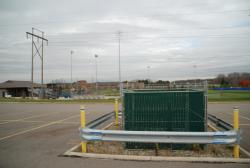 A gas well sits in the parking lot behind Hudson High School