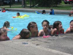 Campers cool off in the pool.