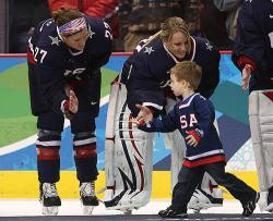 U.S. goalie Brianne McLaughlin of Sheffield celebrates after receiving Silver Medal at Olympic Games