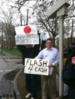 Protestors are trying to get red light traffic cameras banned in Cleveland and Garfield Hts.