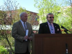 Representatives Kenny Yugo (right) and Mike Skindell unveil their proposal on Wednesday