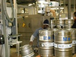 Kegs steadily roll off the line at the Great Lakes Brewing Company in Cleveland. (Photo by Brian Bull)