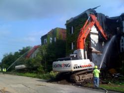 Demolition crews start knocking down apartment buildings in East Cleveland.