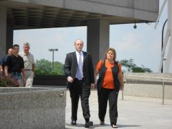 Lori Dimora walks out with family members after learning her husband is sentenced to 28 years in prison.