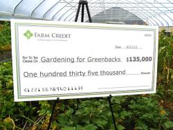 An oversize check for $135,000 proclaims banks' support for the 'Gardening for Greenbacks' program (pic by Brian Bull).