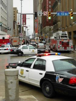Cop cars, fire engines, and police tape block off access to the Sterling Building (pic by Brian Bull)