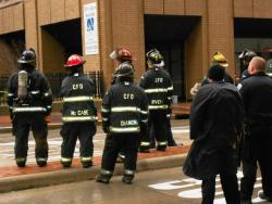 Cleveland Fire Department personnel, standing by.  The Sterling Building was evacauted after 11am (pic by Brian Bull)