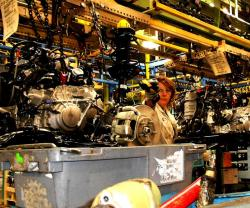 A Honda line worker scans a subassembly, for tracking purposes (pic by Brian Bull).