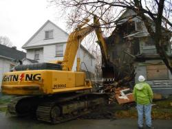 Work crews continue demolishing 6179 Morton Avenue (pic by Brian Bull)