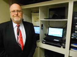 Michael Kumin, funeral director at Berkowitz-Kumin-Bookatz, near the webcasting equipment (pic by Brian Bull).