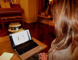Cindy Saltzer pulls up her father's funeral service on her personal laptop (pic by Brian Bull)