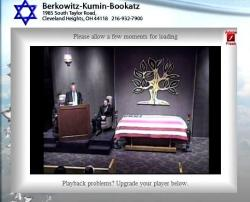An online funeral service provided by the Berkowitz-Kumin-Bookatz Funeral Home, as seen on a laptop.