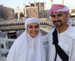 Najia and Faisal with the Kaaba in the background.