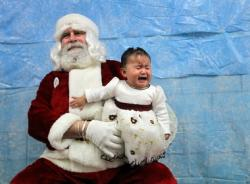 A Painesville girl is unhappy with Santa.  Credit: Lisa DeJong, <i>The Plain Dealer.</i> Used with permission.