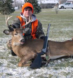 Muzzleloader enthusiast with bagged deer (photo from Ohio DNR website).