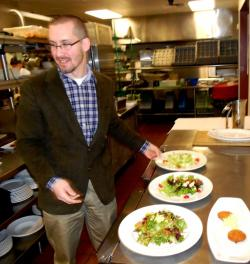 Brian Woehrman, general manager of Lockkeepers Restaurant, readies salads (pic by Brian Bull)