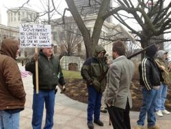 Protesters stand outside the Statehouse in Columbus.