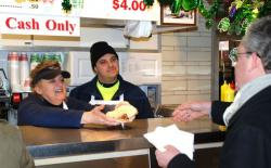 Ilse Sheppard serves up a sandwich at Frank's Bratwurst stand