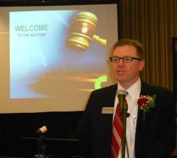 Douglas Johnson of CBRE Auction Services, orients the crowd on the auction process (pic by Brian Bull).