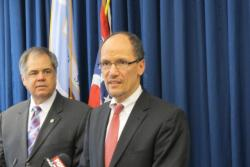 U.S. Assistant Attorney General Thomas Perez , Cleveland Public Safety Director Martin Flask (left)