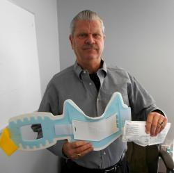 Cryothermic Systems CEO Mike Burke with Excel Cryo Cooling System (pic by Brian Bull)