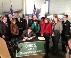Gov. John Kasich signs the transportation bill at a ceremony in Warrensville Heights.