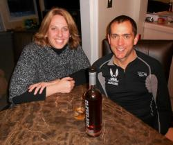 Adrienne and Andy Gordon, sampling Cleveland Whiskey in their Reminderville home (pic by Brian Bull)