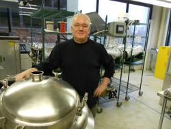 Cleveland Whiskey proprietor Tom Lix, and his special apparatus for aging his whiskey in 60 days (pic by Brian Bull)