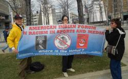 Outside Progressive, a group of Native Americans decry the use of Indian imagery in sports (pic by Brian Bull)