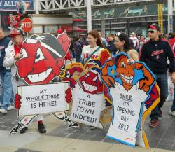 Indian fans pose with signs bearing the team mascot, Chief Wahoo (pic by Brian Bull)