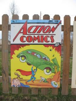 A fence outside where Joe Shuster's apartment used to stand displays Action Comics #1 (pic by Brian Bull)