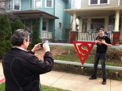 Jeff Aten takes a photo of his son, Alex, in front of the Superman House (pic by Brian Bull)