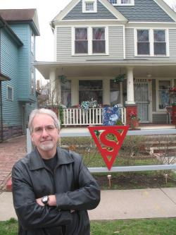 Mike Olszewski, President of the Siegel and Shuster Society, in front of the Superman House (pic by Brian Bull)