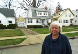 Euclid resident Janis Thompson, whose home is flanked by foreclosures (pic by Brian Bull)