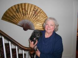 Until the foreclosure crisis is resolved, Janis Thompson and Zoodle the Poodle are resigned to staying put (pic by Brian Bull)