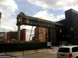 Developers spared the bridge between a parking garage and the P&H Buildings.  It's held up by struts (pic by Brian Bull)