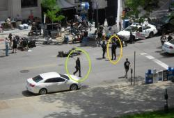 What may be actor Samuel L. Jackson (green circle) and his stunt double (orange circle) in Cleveland (pic by Brian Bull)