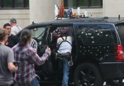 Movie crews prep a bullet-riddled SUV for the day's filming (pic by Brian Bull)