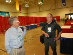 DWD's design manager, Doug Pryor, talks to a visitor at their Manufacturing Mart booth (pic by Brian Bull)