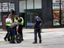 Several local police officers help divert traffic, while film crews continue to set up (pic by Brian Bull)