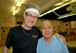 Carlo Wolff and Fumio Yoshikawa during a break in the table tennis action