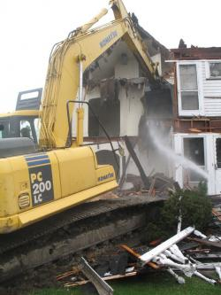 Foreclosed home gets demolished in Cuyahoga County (pic by Brian Bull)