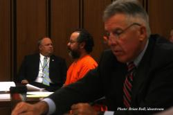 Ariel Castro, at today's hearing.  Cuyahoga County Prosecutor Tim McGinty is in the foreground (pic by Brian Bull)